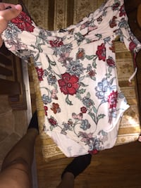 white and multicolored floral long-sleeved one-piece apparel