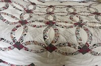Beautiful twin quilt with scalloped edges. There was a small tear on the underside that's been mended but other than that it's in great condition. Clean smoke free home 166 mi