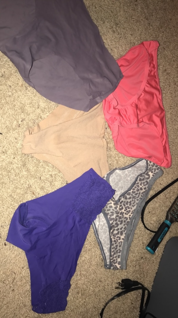 four women's assorted-color panties