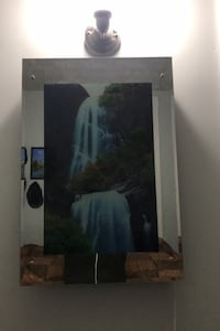 Waterfall mirror with sounds