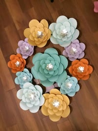 assorted-color paper flower backdrops 27 km