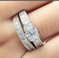 silver-colored diamond encrusted wedding ring set