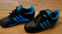 pair of black-and-blue Adidas sneakers Springfield