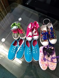 six pairs of low top sneakers