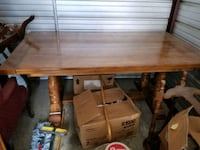 Solid oak dining room table. Matching chairs and inserts included