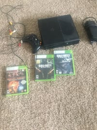 black Xbox One console with controller and game cases Kenai, 99611