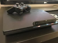 PS3 Slim With 4 Games