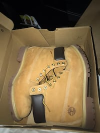 Timberland Boots Men Sz 10 only worn once! Great condition for $100.