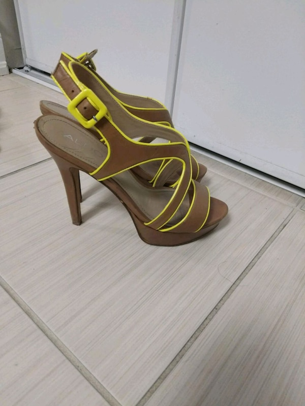 pair of open toe ankle strap heels d0d686bd-87f7-47f9-bfb6-53d823739f18