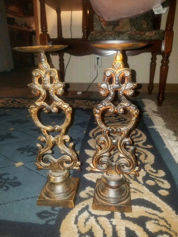 two gray-and-brown candle holders