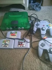 green Nintendo 64 console with controller and game cartridges Huntington Beach, 92647