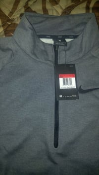 Grey Nike sweater with the tags still attached London, N6J