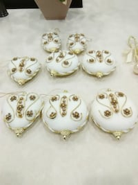 8 assorted gold ornaments