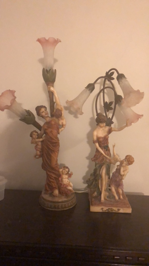 Two Brown Wooden Angel Figurines