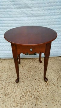 Bombay wood round accent table  Bartlett