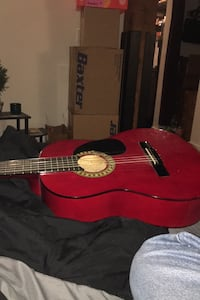 Gently used Acoustic Guitar