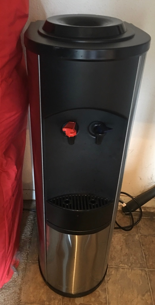 Photo Water Cooler, stainless/black, hot/cold, electric, for bottled water.