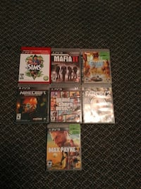 four assorted PS3 game cases
