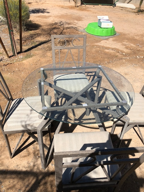 Round Glass table top metal frame and 4 chairs
