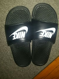 pair of black Nike slide sandals 1965 km