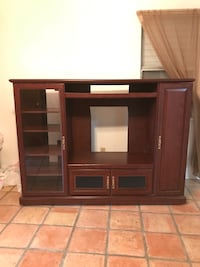 brown wooden TV hutch with flat screen TV Corpus Christi, 78415