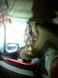 cone-shaped white lampshade with brass-colored base