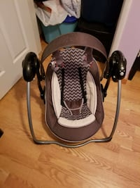 baby's grey, white, and black portable swing