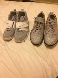 two pairs of white and black Nike sneakers Windsor, N9C 3L5