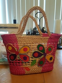 brown,pink,purple and green wicker basket