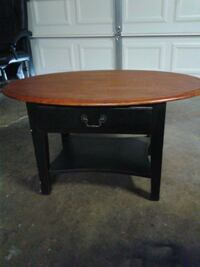 Cute small oval coffee table with drawer.