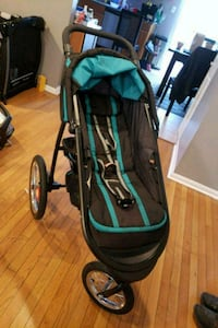 baby's black and blue jogging stroller 27 km
