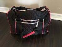 quilted black and pink duffle bag