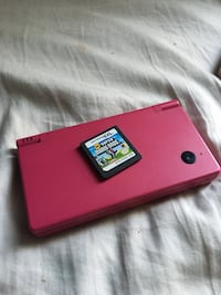red Nintendo DS with game cartridge Wilmot, N0B
