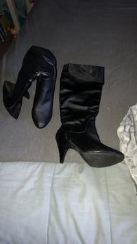 Pair of black leather heeled knee-high boots size 7