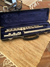 silver-colored flute with case Stallings, 28104