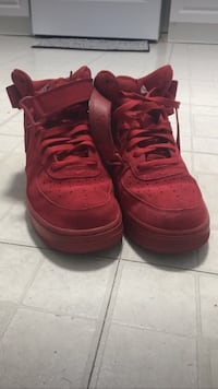 pair of red Nike air basketball shoes