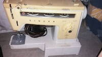 white and black electric sewing machine Calgary