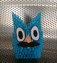 Blue owl with a big eyes and a small moustache.  Madurai, 625020