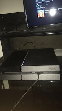 black Sony PS4 game console CHANTILLY