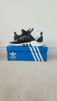 pair of black adidas NMD shoes with box 570 km