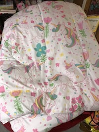Unicorn bedspread with one set of matching twin bed sheets.