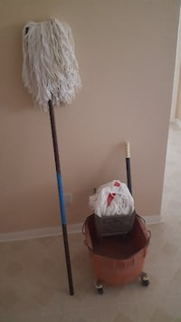 white floor mop with bucket