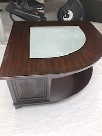 brown wooden framed glass top table Houston, 77088