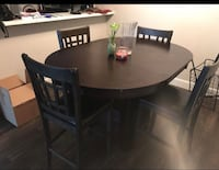 round brown wooden table with four chairs dining set Houston, 77084