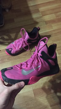 Pair of pink-and-black nike basketball shoes
