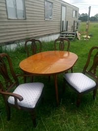 round brown wooden table with four chairs dining set Rayne, 70578