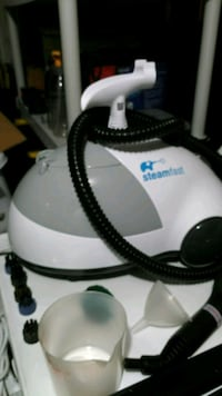 White and Black canister steam  cleaner