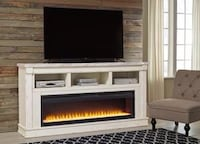 Becklyn Chipped White XL TV Stand with Wide Fireplace Insert | W642-68 Houston, 77036