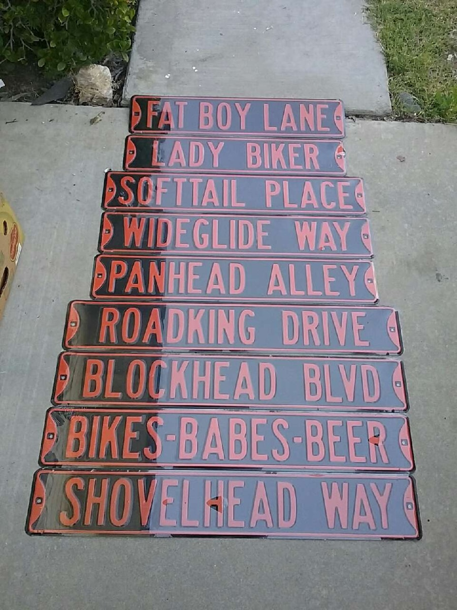9 assorted Harley Davidson st. signs $15 each.