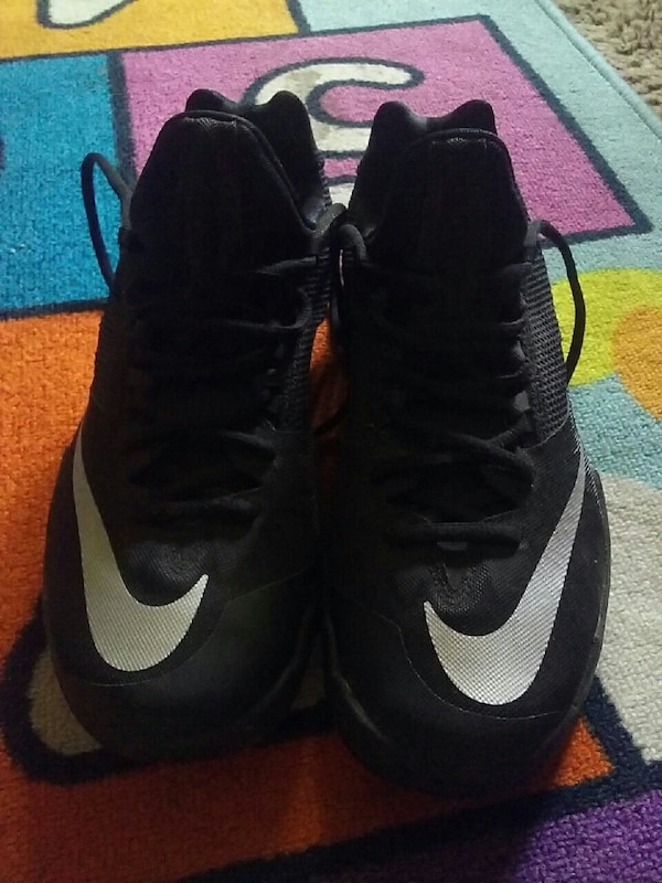 pair of black Nike sneakers